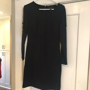 Black fitted dress w/ covered button sleeve detail